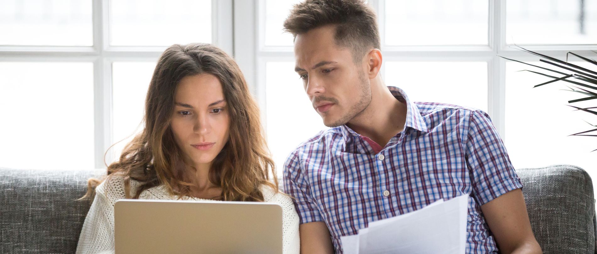 young couple review financial situation during current crisis